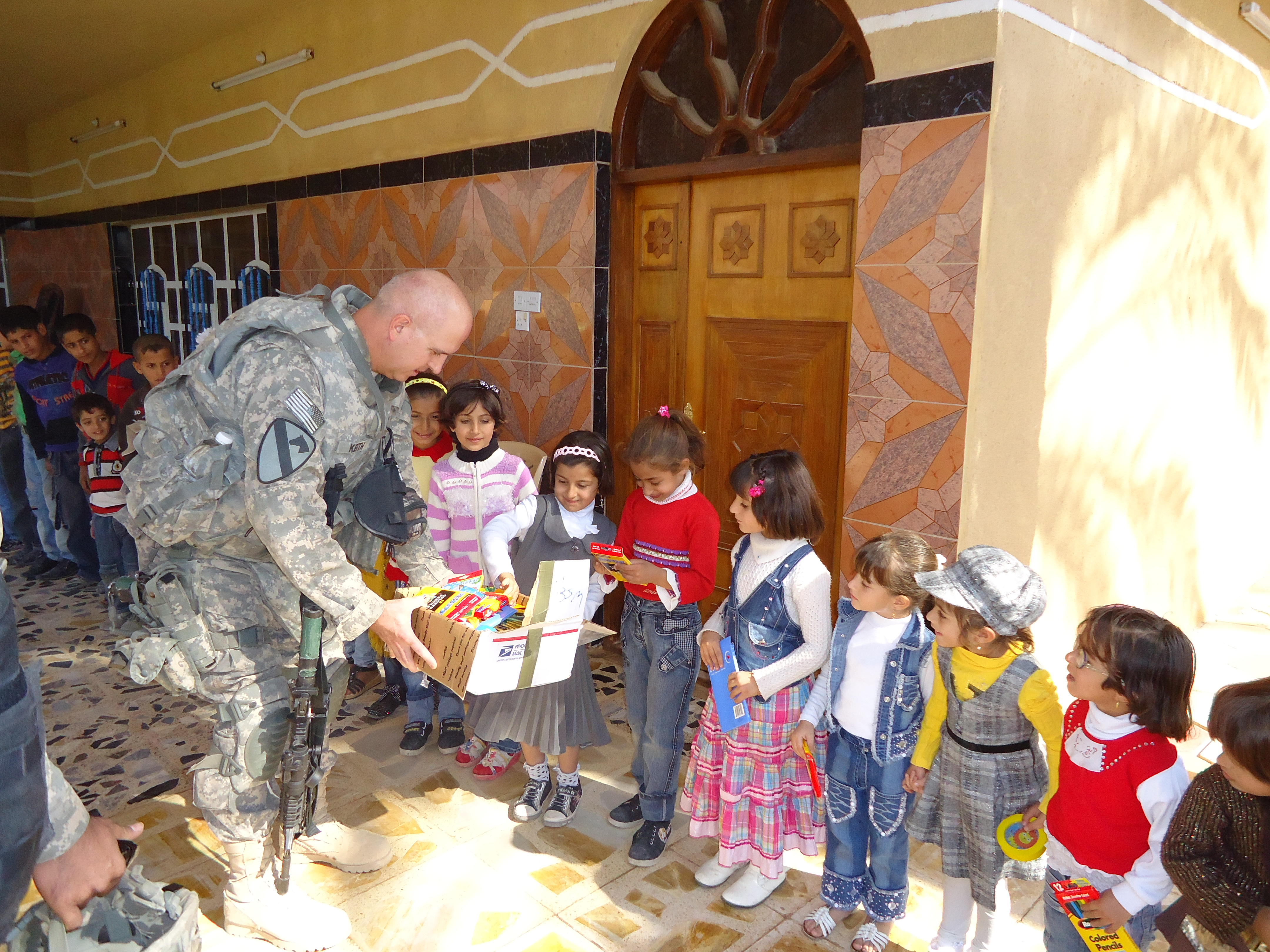 photo of James Keith and Iraqi children