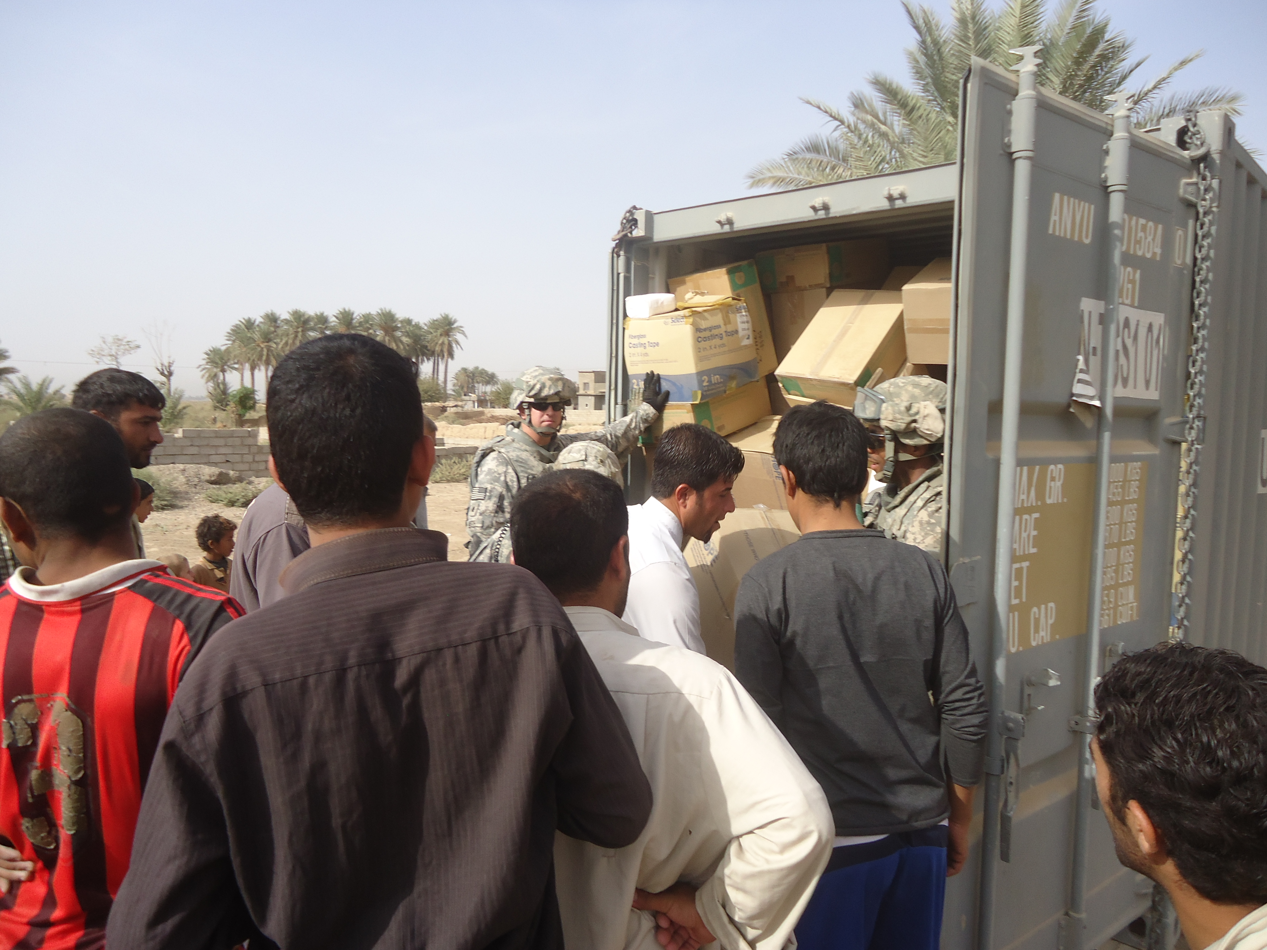 photo of James Keith handing out supplies to Iraqis