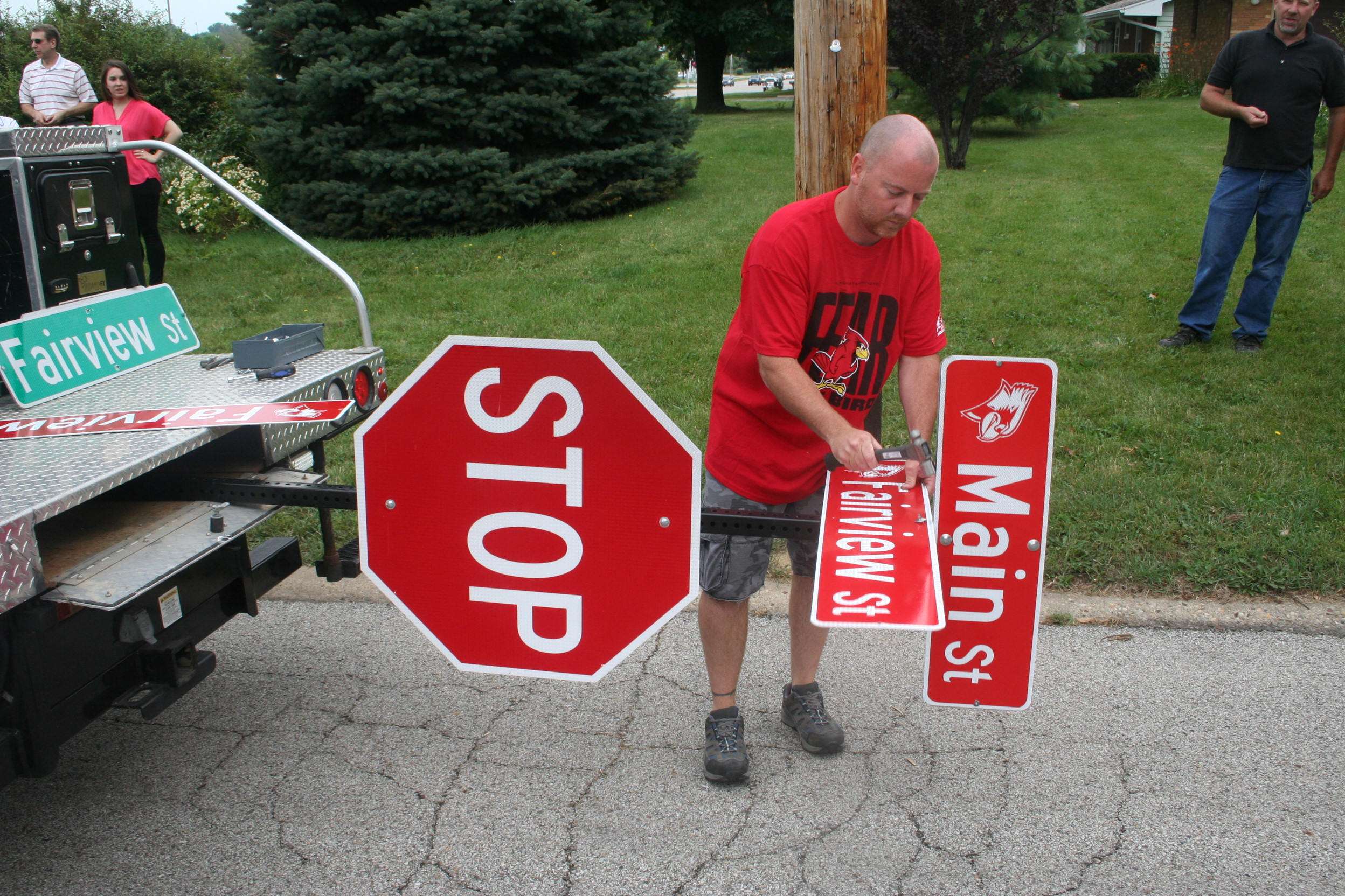 Photo of Redbird street sign installation