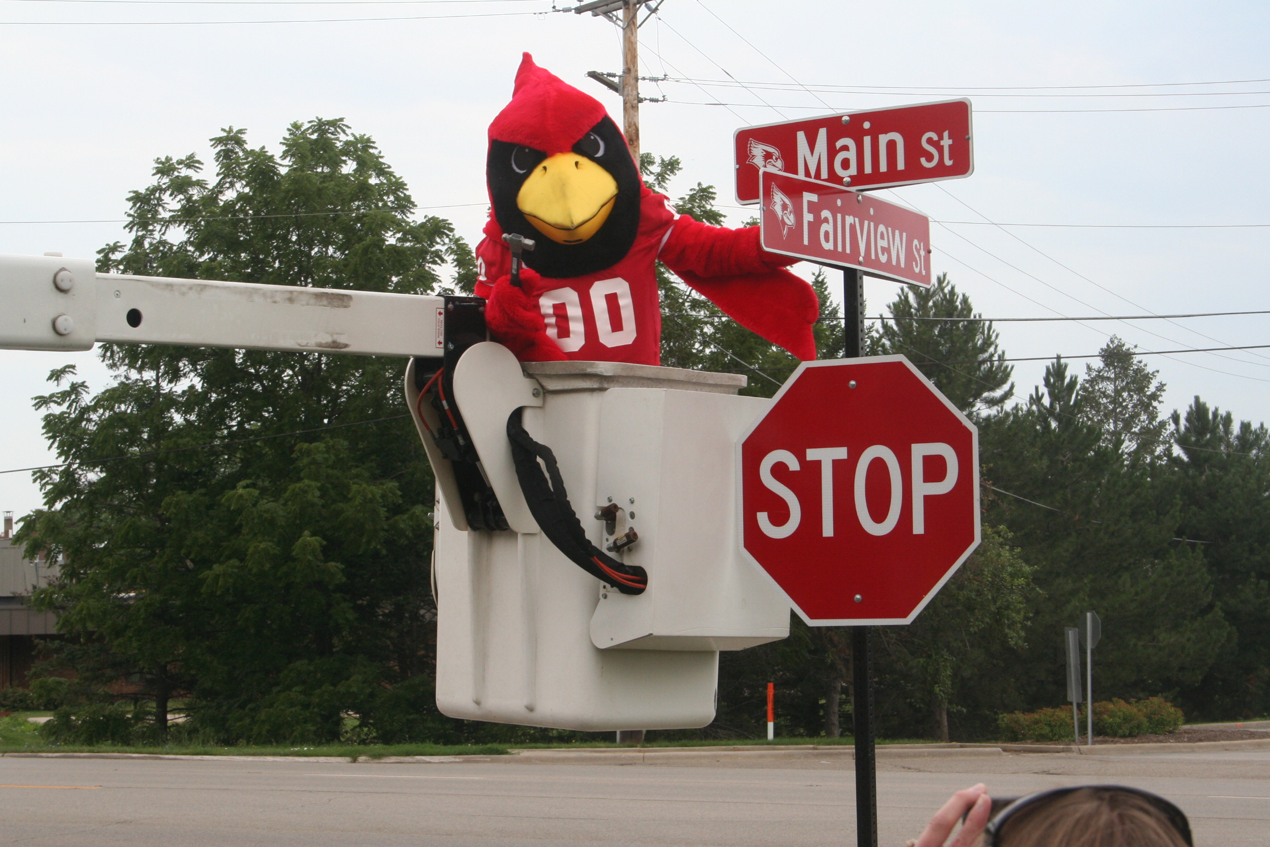 Photo of Reggie Redbird and street signs